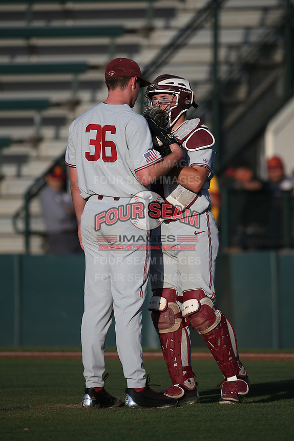 Maverick Handley (10) of the Stanford Cardinal talks with pitcher Kris Bubic (36) during a game against the Southern California Trojans at Dedeaux Field on April 6, 2017 in Los Angeles, California. Southern California defeated Stanford, 7-5. (Larry Goren/Four Seam Images)
