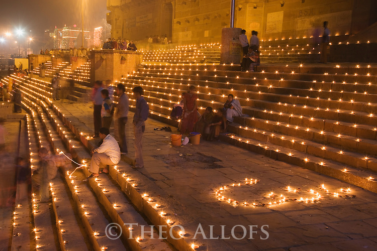 Thousands of candles on Ghats (stairs) during Full Moon Festival in November;  Varanasi has been a cultural and religious center in northern India for several thousand years, Varanasi, Uttar Pradesh, India