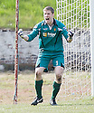 Albion keeper Derek Gaston after he saved the penalty ....