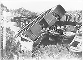 Aftermath of Barranca Hill wreck on July 17, 1929.  Baggage/RPO car #121 is off the trestle.  The cab of K-28 #474 is visible.<br /> D&amp;RGW  Barranca Hill, NM  7/17/1929