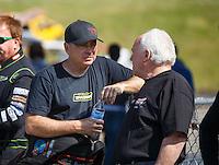 May 22, 2016; Topeka, KS, USA; NHRA top fuel driver Scott Palmer (left) with Luigi Novelli during the Kansas Nationals at Heartland Park Topeka. Mandatory Credit: Mark J. Rebilas-USA TODAY Sports