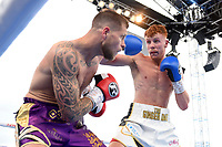 Connor Wright (white shorts) defeats Owen Jubburn during a Boxing Show at Stevenage Football Club on 18th May 2019