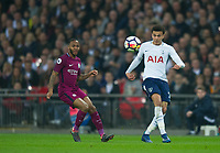 Tottenham's Dele Alli and Manchester City Raheem Sterling during the Premier League match between Tottenham Hotspur and Manchester City at Wembley Stadium, London, England on 14 April 2018. Photo by Andrew Aleksiejczuk / PRiME Media Images.