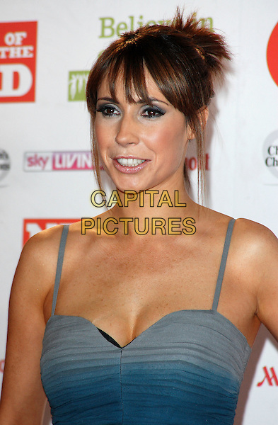ALEX JONES .Attending the News of the World Children's Champions Awards at the Grosvenor House Hotel, Park Lane, London, England, UK, March 30th 2011..portrait headshot fringe hair up  make-up eyeshadow tanned cleavage  blue teal ombre .CAP/ROS.©Steve Ross/Capital Pictures