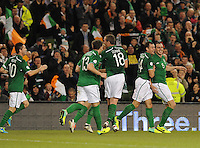 15th October 2013; John O'Shea, Ireland, celebrates with Darron Gibson and other team mates after scoring his side's second goal. World Cup Qualifier Group C, Republic of Ireland v Kazakhstan, Aviva Stadium, Dublin. Picture credit: Tommy Grealy/actionshots.ie.