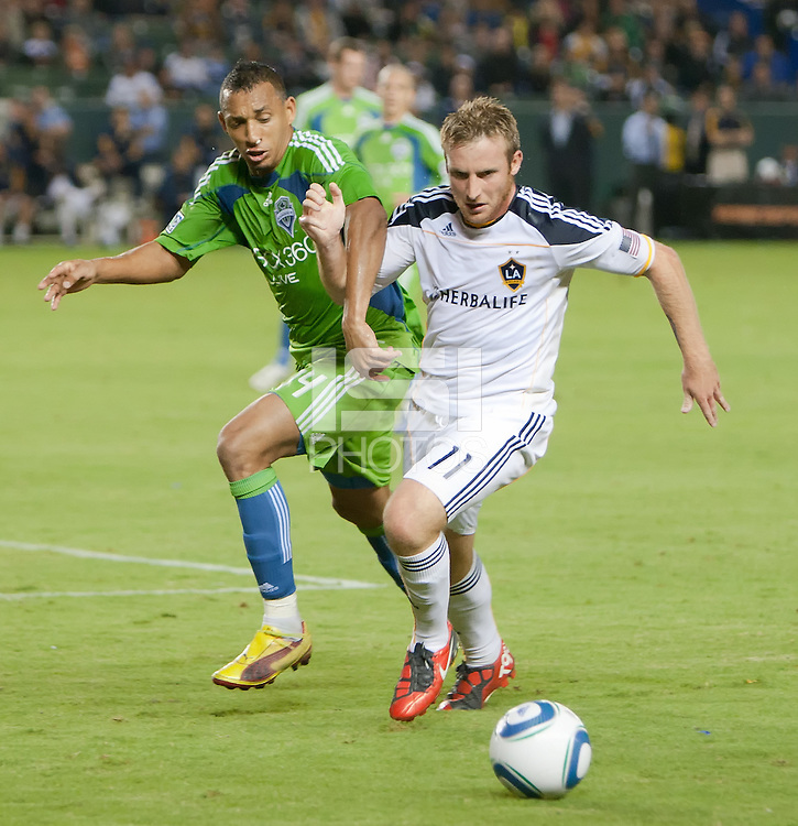 CARSON, CA – NOVEMBER 7:  Seattle Sounders defender Tyrone Marshall (14) and LA Galaxy midfielder Chris Birchall (11) during a soccer match at the Home Depot Center, November 7, 2010 in Carson, California. Final score LA Galaxy 2, Seattle Sounders 1.
