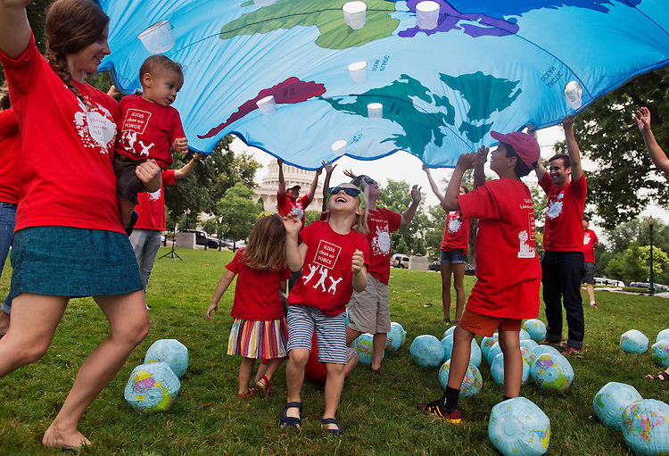 """UNITED STATES - JULY 09: Kids including Reinaldo Alfonso, 5, of Philadelphia, participates in a """"play-In"""" in Upper Senate Park to protest air pollution that causes climate change, July 9, 2014. The event, held by parent-activist groups, called on Congress to support the EPA's Clean Power Plan, that would limit carbon emissions from existing power plants. (Photo By Tom Williams/CQ Roll Call)"""