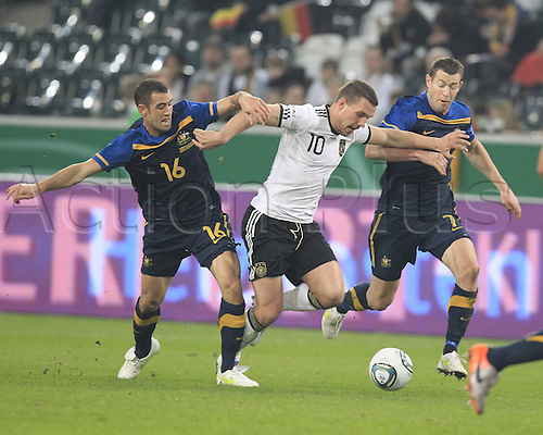 29 03 2011  v D Laage Football international match Friendly match Germany vs Australia 29 03 2011 Borussia Park Stadium Moenchengladbach Carl Valeri Lukas Podolski Board Emerton Football men ger DFB National team international match Moenchengladbach