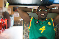 Hartford, CT - Friday June 13, 2014: Cameroonian-American David Abunaw watches the Cameroon vs. Mexico FIFA World Cup first round match at Damons Tavern in Hartford, CT.