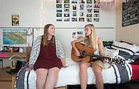 Roommates Meike Buhaly '18 (guitar) and Anne Marie Crooke '18 in Braun Hall, May 3, 2016.<br /> (Photo by Marc Campos, Occidental College Photographer)