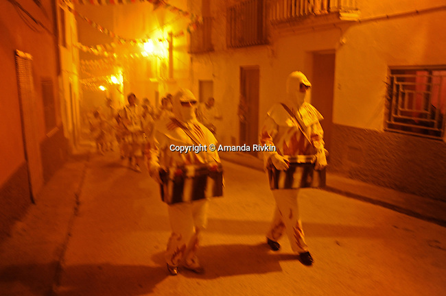 "Following the solemn act of a Sunday procession, a midnight pagan ritual, ""Corre Fuegos"" or ""Running with Fire"" begins as locals are chased through the streets by flame throwing and firework yielding men dressed in all white during the municipal fiestas in the town of Costur, Spain on August 17, 2009."