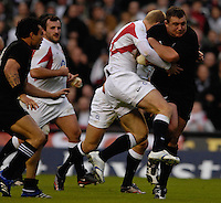 Twickenham. GREAT BRITAIN, Ian BALSHAW Hangs on to Tony WOODCOCK, as he breaks through, during the, 2006 Investec Challenge, game between, England  and New Zealand [All Blacks], on Sun., 05/11/2006, played at the Twickenham Stadium, England. Photo, Peter Spurrier/Intersport-images].....   [Mandatory Credit, Peter Spurier/ Intersport Images].