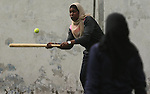 "Palestinian girls take part in Baseball training, in Gaza city, on February 20, 2017. Baseball is a bat-and-ball game played between two teams of nine players each, who take turns batting and fielding. Baseball is thought to have originated as a game called ""rounders"" in England and gained popularity in the United States in the early 1900s. It has gone by many names in the past, including ""town ball,"" ""goal ball,"" round ball,"" and simply ""base,"" just to name a few. Photo by Ashraf Amra"
