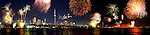 Panoramic scenery of colorful firework display over the city of Toronto waterfront on Canada day. Multiple exposure digitally altered image.