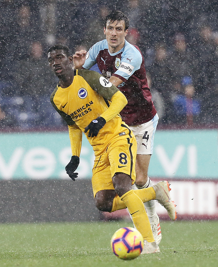 Brighton & Hove Albion's Yves Bissouma passes despite the attentions of Burnley's Jack Cork<br /> <br /> Photographer Rich Linley/CameraSport<br /> <br /> The Premier League - Burnley v Brighton and Hove Albion - Saturday 8th December 2018 - Turf Moor - Burnley<br /> <br /> World Copyright © 2018 CameraSport. All rights reserved. 43 Linden Ave. Countesthorpe. Leicester. England. LE8 5PG - Tel: +44 (0) 116 277 4147 - admin@camerasport.com - www.camerasport.com