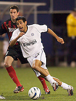 Pablo Mastroeni of the Rapids being chased by Mark Lisi of the MetroStars. The Colorado Rapids lost to the NY/NJ MetroStars 2-1 on 5/3/03 at Giant's Stadium,East Rutherford, NJ.