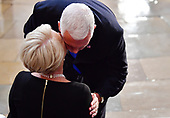 Vice President of the United States Mike Pence kisses Cindy McCain as the casket of former Senator John McCain in the Capitol Rotunda lies in state at the U.S. Capitol, in Washington, DC on Friday, August 31, 2018. McCain, an Arizona Republican, presidential candidate and war hero died August 25th at the age of 81. He is the 31st person to lie in state at the Capitol in 166 years.    Photo by Kevin Dietsch/UPI