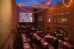 The Foreign Cinema in the Mission District shows films projected on the wall of its outdoor patio where the audio is made available through vintage drive-in theater speakers next to the dining tables