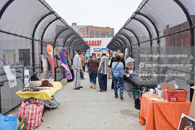 Vendor stalls on an highway overpass are seen at Detroit Eastern Farmers market in Detroit (Mi) Saturday June 8, 2013. The largest open-air flowerbed market in the United States, the Eastern Market is a historic commercial district in Detroit, Michigan.
