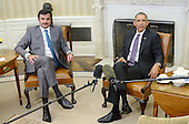 United States President Barack Obama meets with the Amir of Qatar, His Highness Sheikh Tamim bin Hamad al Thani, in the Oval Office of the White House February 24, 2015 in Washington, DC.<br /> Credit: Olivier Douliery / Pool via CNP