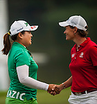 TAOYUAN, TAIWAN - OCTOBER 27:  Catriona Matthew of Scotland and Inbee Park of South Korea shake hands on the 18th green during the day three of the Sunrise LPGA Taiwan Championship at the Sunrise Golf Course on October 27, 2012 in Taoyuan, Taiwan.  Photo by Victor Fraile / The Power of Sport Images