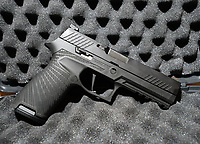 Wilson Combat in Berryville is working with gun maker Sig Sauer to provide custom work on two of the company's most popular handguns. This P320, seen Wednesday, March 4, 2020, features the Wilson Combat starburst stipple pattern as well as improved machine work and Wilson Combat logo. Visit nwaonline.com/200308Daily/ for today's photo gallery.<br /> (NWA Democrat-Gazette/Andy Shupe)