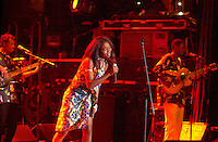 July 12 2002, Montreal, Quebec, Canada<br /> <br /> H'sao from Chad, opens for FEMI KUTI &  The POsitive Force at  the Spectrum, in Montreal, Canada, July 12, 2002 during the Nuits d'afrique Festival.<br /> <br /> Hirondelle Sao serves up timeless sai, n'dala and ngandja traditions painted with subtle strokes of soul, jazz and R&B. <br /> <br /> The princely son of indomitable Fela is now an Afrobeat king in his own right. Traditional Yoruba rhythms and melodies are married to funk and jazz, soul, salsa and hip hop. Femi's latest release is aptly titled Fight To Win.<br /> <br /> Mandatory Credit: Photo by Pierre Roussel- Images Distribution. (©) Copyright 2002 by Pierre Roussel <br /> <br /> NOTE : <br />  Nikon D-1 jpeg opened with Qimage icc profile, saved in Adobe 1998 RGB<br /> .Uncompressed  Uncropped  Original  size  file availble on request.