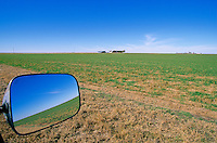 Vast horizons of Great Plains ,view in rearview mirror along Highway 64, near Alva, Oklahoma, AGPix_0260.