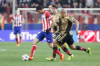 Atletico de Madrid´s Diego Costa (L) and Milan´s Nigel de Jong and Andrea Poli during 16th Champions League soccer match at Vicente Calderon stadium in Madrid, Spain. March 11, 2014. (ALTERPHOTOS/Victor Blanco)
