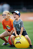 Two young fans take part in a promotional event during an Oklahoma City Dodgers game against the Colorado Springs Sky Sox on June 2, 2017 at Chickasaw Bricktown Ballpark in Oklahoma City, Oklahoma.  Colorado Springs defeated Oklahoma City 1-0 in ten innings.  (Mike Janes/Four Seam Images)