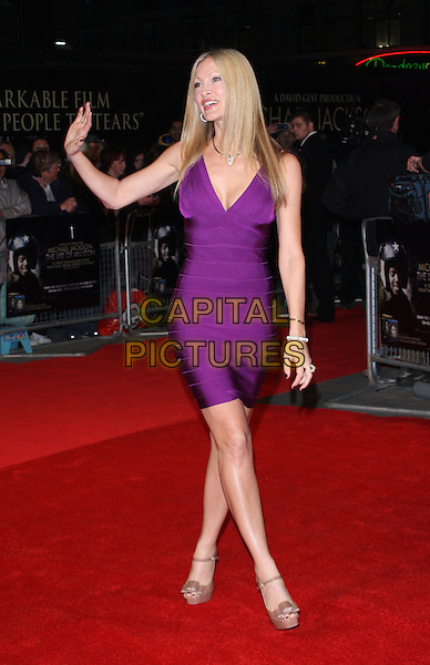 "Caprice Bourret.The ""Michael Jackson : The Life Of An Icon"" UK premiere, Empire cinema, Leicester Square, London, England..2nd November 2011.full length purple dress brown peep toe shoes hand arm waving .CAP/ROS.©Steve Ross/Capital Pictures."