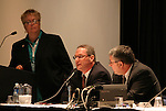 "17 January 2004: USSF secretary general Dan Flynn (center) with Soccer America publisher Lynn Berling-Manuel (left) and Boston Breakers general manager Joe Cummings (right) during a panel discussion titled ""Can Women's Professional Soccer Survive in America"" at the Charlotte Convention Center in Charlotte, NC as part of the annual National Soccer Coaches Association of America convention.."