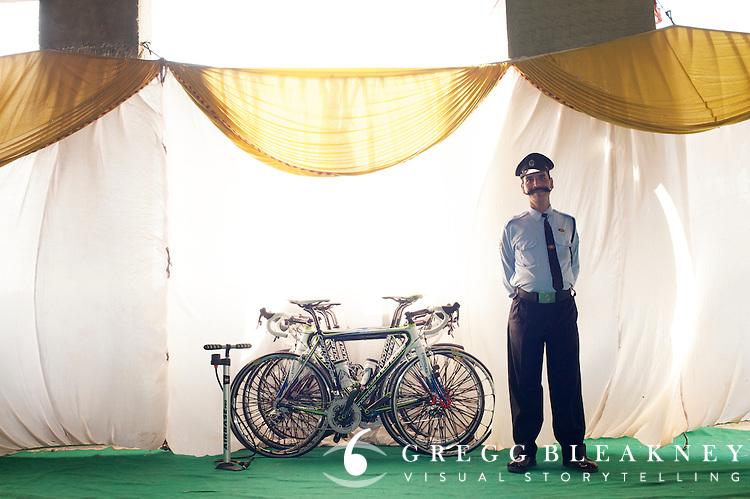 Security guard watches Team Liquigas bicycles - Tour of Nashik India