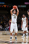 Mitchell Wilbekin (10) of the Wake Forest Demon Deacons attempts a free throw during second half action against the Minnesota Golden Gophers at the LJVM Coliseum on December 2, 2014 in Winston-Salem, North Carolina.  The Golden Gophers defeated the Demon Deacons 84-69. (Brian Westerholt/Sports On Film)