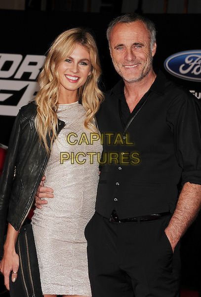 HOLLYWOOD, CA- MARCH 06: Actors Timothy V. Murphy (R) and Caitlin Manley arrive at the Los Angeles premiere of 'Need For Speed' at TCL Chinese Theatre on March 6, 2014 in Hollywood, California.<br /> CAP/ROT/TM<br /> &copy;TM/Roth Stock/Capital Pictures