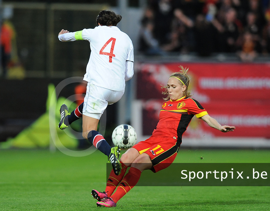 20140410 - LEUVEN , BELGIUM : Belgian Janice Cayman (11) pictured with Norwegian Ingvild Stensland (4) during the female soccer match between Belgium and Norway, on the seventh matchday in group 5 of the UEFA qualifying round to the FIFA Women World Cup in Canada 2015 at Stadion Den Dreef , Leuven . Thursday 10th April 2014 . PHOTO DIRK VUYLSTEKE