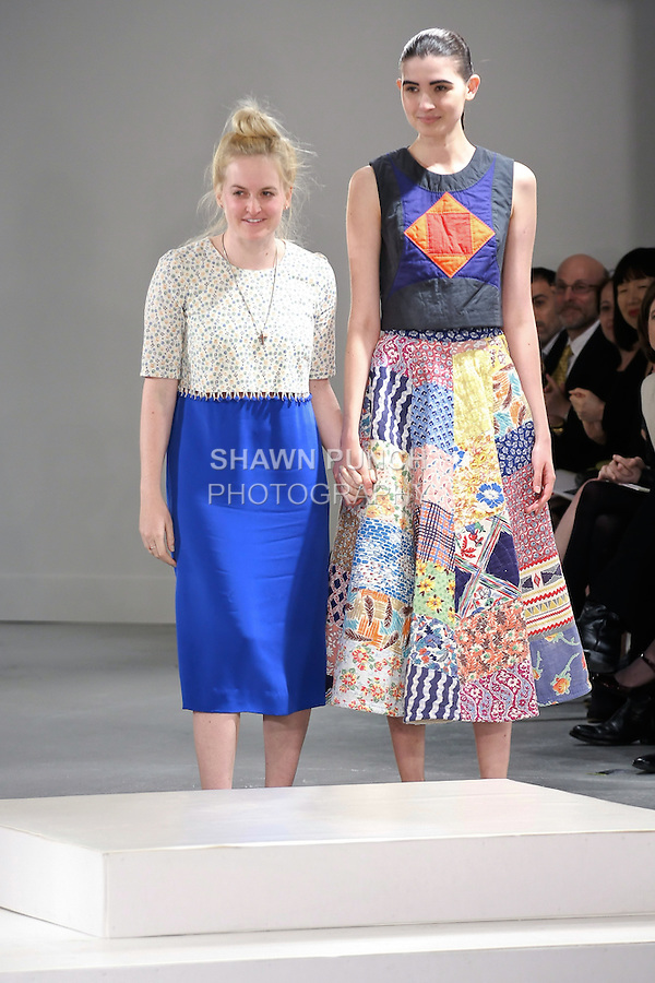 Graduting student designer Kelsey Carleen Parkhouse, walks runway with model at the close of the 2012 Pratt Institute fashion show, at Center548 NYC, on April 26, 2012.