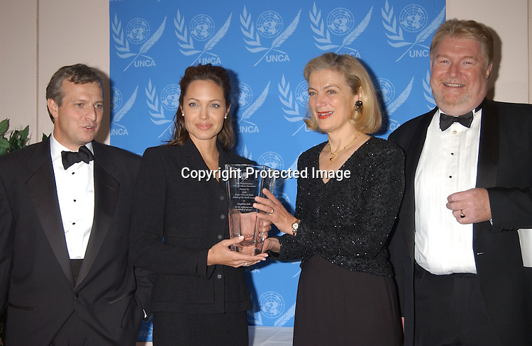 ..Tony Jenkins, Angelina Jolie, Nane Annan and Ian ..Williams..at the United Nations to accept the First UNCA Citizen of the World Award from the United Nations Correspondents Association on October 22, 2003. Photo by Robin Platzer, ..Twin Images