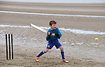 He's more used to playing soccer for East Meath United but Davin O'Connor certainly had a good go at the beach cricket festival in Bettystown. Photo: Andy Spearman.