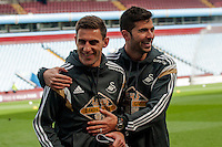 Re: Saturday 21st March 2015 <br /> Pictured: Angel Rangel and Jordi Amat of Swansea City  mess around proper to the game at Villa Park <br /> Re: Barclays Premier League Aston Vila v Swansea City at Villa Park, Birmingham, UK
