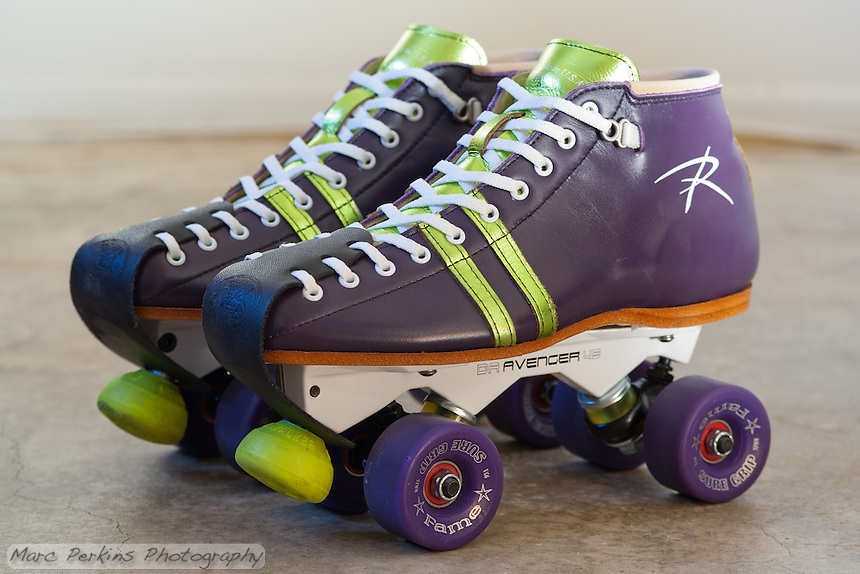 Michelle's custom (Color Lab) Riedell 495 roller skate boots mounted to a Sure-Grip Magnesium (white) Avenger plate.  The wheels are purple Sure Grip Fames, the bearings are Bones China Reds, the cushions are Sure Grip Yellows the toe stops are Moonwalkers, they have white laces, and a black Riedell leather toe protector.