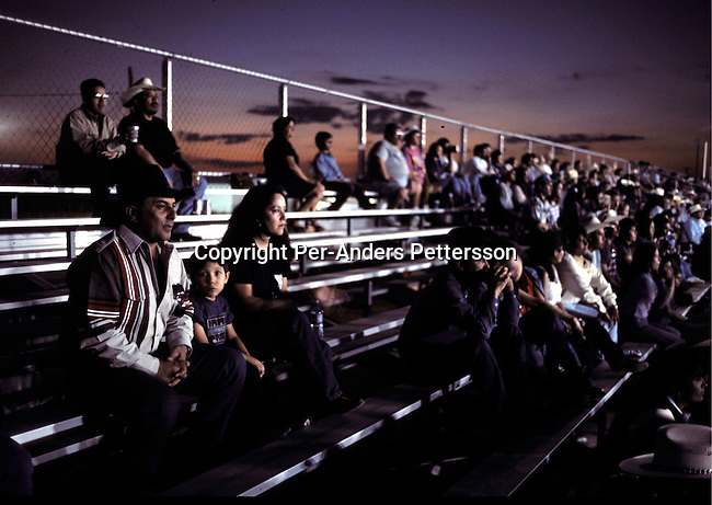 Unidentified Rodeo fans looking at a Rodeo on July 13, 1998 in Brownsville, Texas, USA. They are attending a yearly rodeo held at a local stadium. Rodeo is on of the most popular pastimes in this area. .(Photo: Per-Anders Pettersson/Getty Images).
