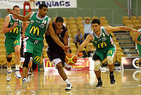 Jets' Daryl Hudson and Kaine Hokianga try to stop Corey Webster (centre) during the NBL match between Manawatu Jets and Harbour Heat at Arena Manawatu, Palmerston North, New Zealand on Saturday 17 April 2010. Photo: Dave Lintott / lintottphoto.co.nz