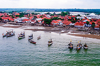 Java, East Java, Madura. Small village in the Sampang regency on south Madura with traditional vessels (from helicopter)