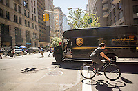 A UPS truck turns a corner in New York on Tuesday, September 15, 2015. United parcel Service announced that it will hire up to 95,000 seasonal workers to handle the expected crush of packages during this years holiday season. (© Richard B. Levine)