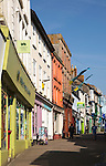 Row of colourful shops in town centre, Penzance, Cornwall, England, UK
