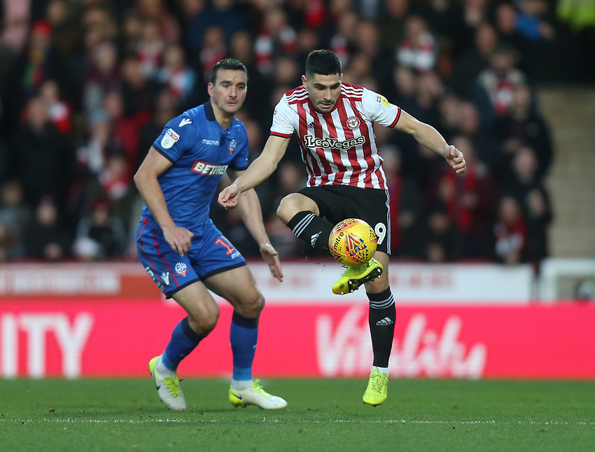 Brentford's Neal Maupay and Bolton Wanderers' Jack Hobbs<br /> <br /> Photographer Rob Newell/CameraSport<br /> <br /> The EFL Sky Bet Championship - Brentford v Bolton Wanderers - Saturday 22nd December 2018 - Griffin Park - Brentford<br /> <br /> World Copyright © 2018 CameraSport. All rights reserved. 43 Linden Ave. Countesthorpe. Leicester. England. LE8 5PG - Tel: +44 (0) 116 277 4147 - admin@camerasport.com - www.camerasport.com