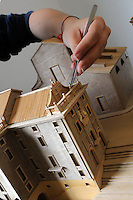 "Istituto Statale d'Arte e Liceo Artistico Roma 2.Esercitazione didattica della sezione di architettura.Studenti mentre lavorano al plastico in legno del  ""Navale del porto di Ripetta"".State Institute of Art and Art School Roma.Practice teaching in the architecture section.Students while working on the plastic timber of the ""Ship of the Port of Ripetta""..."