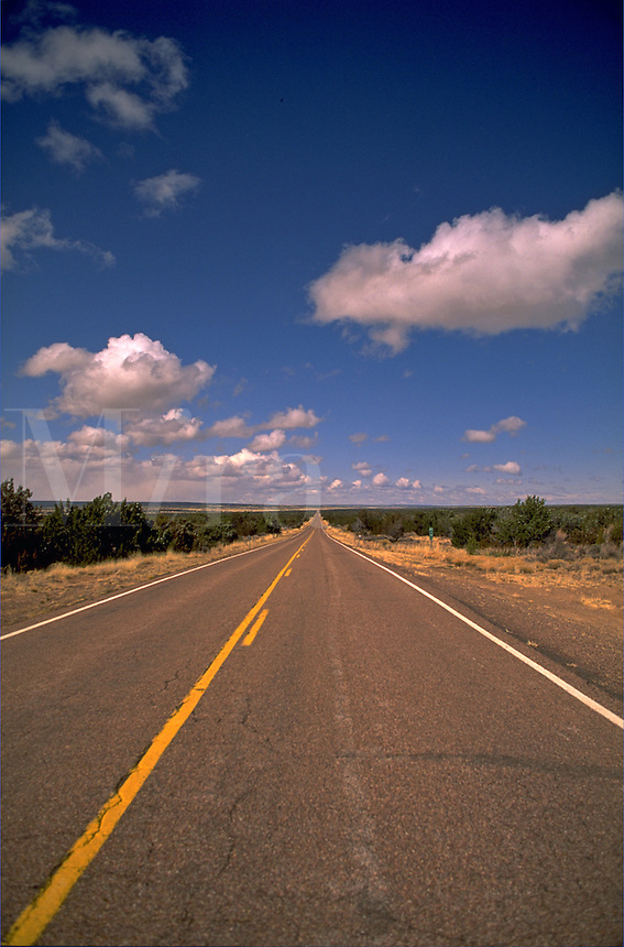 A deserted road under a wide, blue sky. Arizona.
