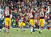 Washington Redskins defensive players celebrate cornerback Bashaud Breeland's (26) interception with 1:30 left in the fourth quarter against the Philadelphia Eagles at FedEx Field in Landover, Maryland on Saturday, December 20, 2014.  The interception helped set-up the game-winning field goal.  The Redskins won the game 27 - 24.<br /> Credit: Ron Sachs / CNP